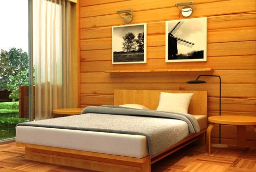Лаконичная спальня в деревянном доме