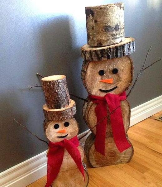 снеговики из спилов дерева