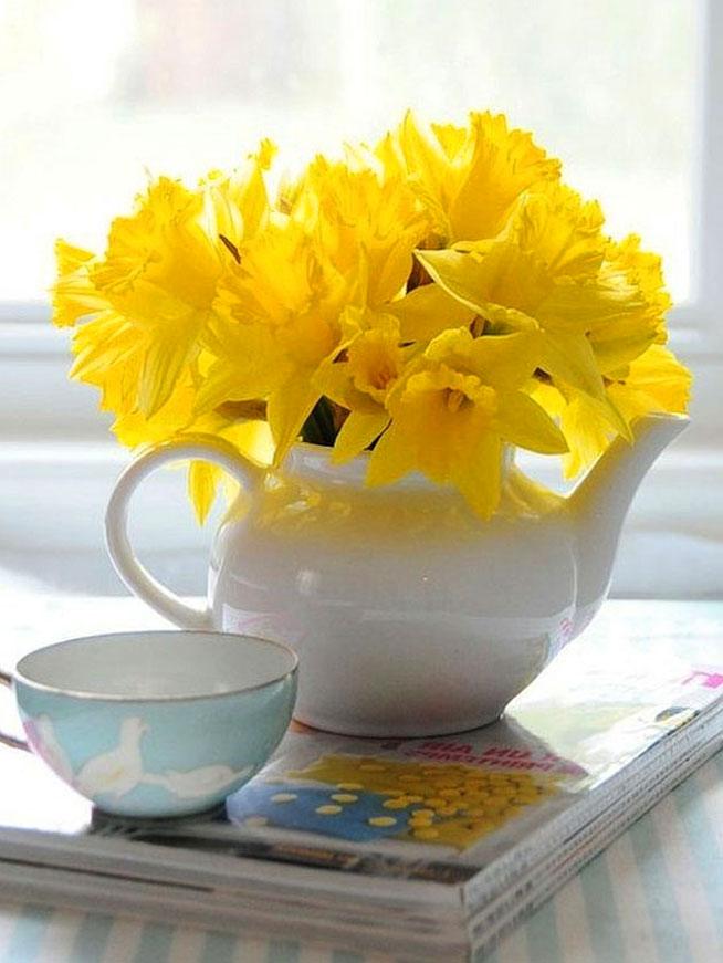 цветы в чайнике